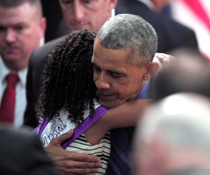President Barack Obama hugs Maryanna Copeny of Flint, Michigan, age 8, after speaking at Northwest High School about the Flint water contamination crisis on May 4, 2016 in Flint, Michigan. While in Flint, the President heard first-hand from residents about the water crisis, and received an in-person briefing on the federal efforts that are in place to help respond to the needs of the city's residents. (Photo by Bill Pugliano/Getty Images)