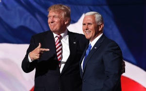 Republican presidential candidate Donald Trump stands with Republican vice presidential candidate Mike Pence and acknowledge the crowd on the third day of the Republican National Convention on July 20, 2016 at the Quicken Loans Arena in Cleveland, Ohio. Republican presidential candidate Donald Trump received the number of votes needed to secure the party's nomination. An estimated 50,000 people are expected in Cleveland, including hundreds of protesters and members of the media. The four-day Republican National Convention kicked off on July 18.  (Photo by Chip Somodevilla/Getty Images)
