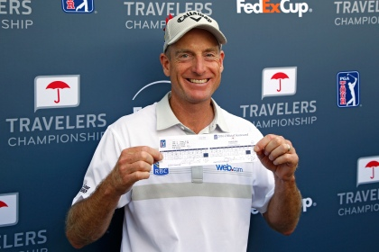 CROMWELL, CT - AUGUST 07: Jim Furyk of the United States poses with his scorecard after shooting a record setting 58 during the final round of the Travelers Championship at TCP River Highlands on August 7, 2016 in Cromwell, Connecticut. (Photo by Michael Cohen/Getty Images)