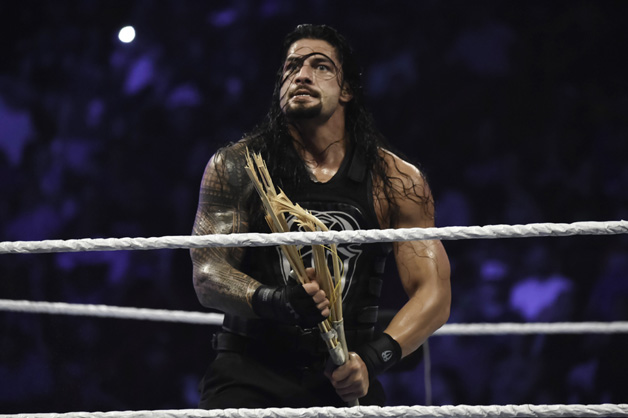 Roman Reigns looks on during the WWE Smackdown on September 1, 2015 at the American Airlines Arena in Miami, Florida.
