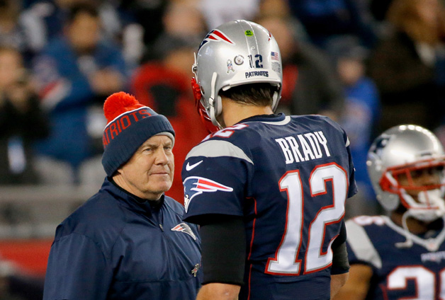 Head coach Bill Belichick talks with Tom Brady #12 of the New England Patriots before a game against the Seattle Seahawks at Gillette Stadium on November 13, 2016 in Foxboro, Massachusetts.